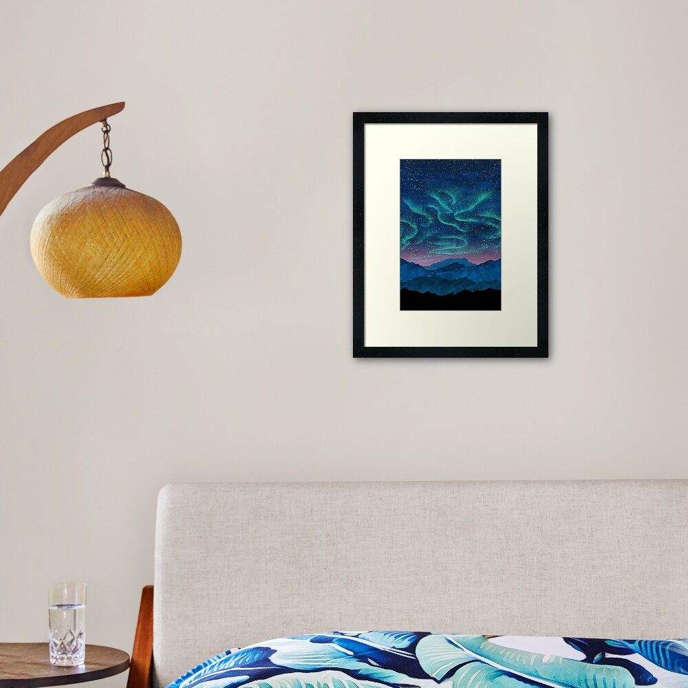 Aurora borealis over mountains Framed Art Print