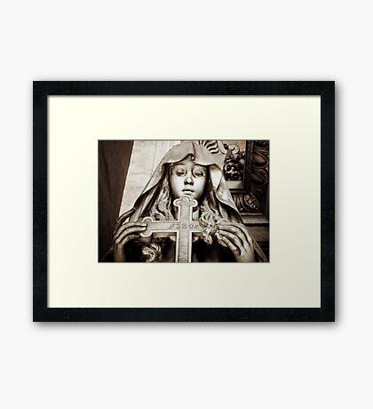 Holding the cross Framed Print