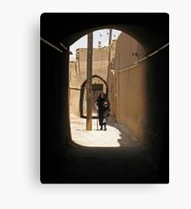 Veiled woman in the streets of Yazd, Iran Canvas Print