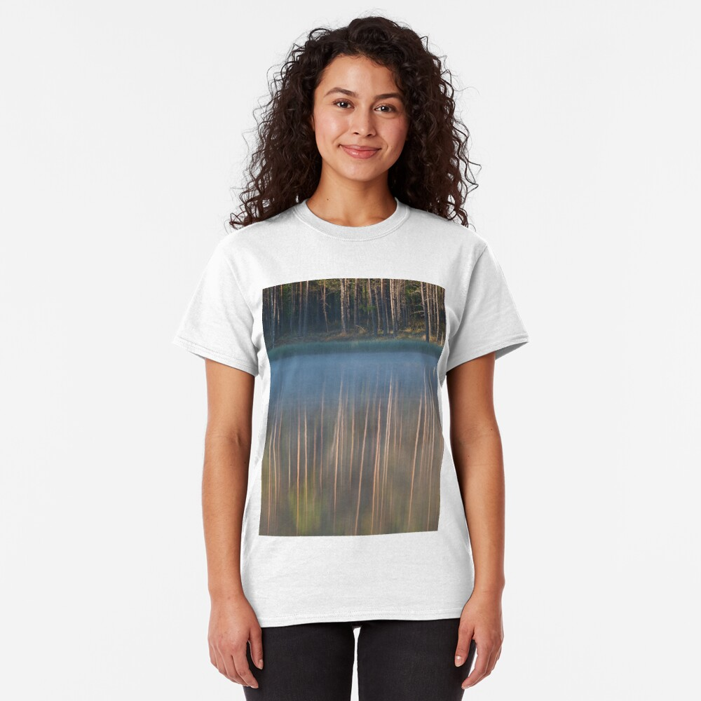Forest reflecting to small lake at morning Classic T-Shirt