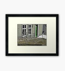 Grey house, green door. Framed Print