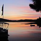 Serenity is a Boat on a Lake in Maine by Debbie Robbins