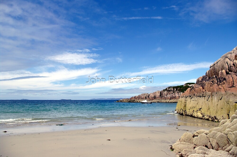 Scottish beach on Mull looking towards small hebridean islands by John Butterfield