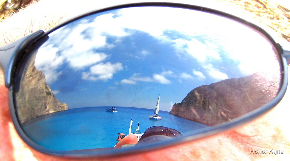 Sunglass Reflection - Navagio Sea and Cliffs by Honor Kyne