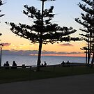Scarborough beach sunset with silhouttes of trees by AriaTees