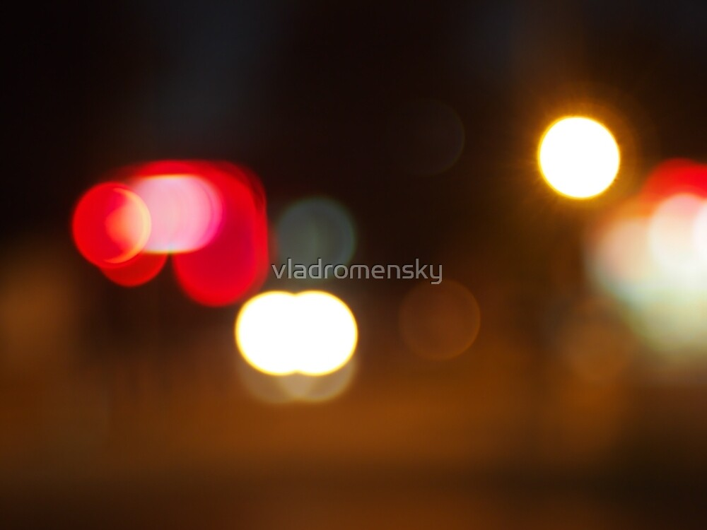 Abstract blur image of round spots of bright multicolored lights by vladromensky