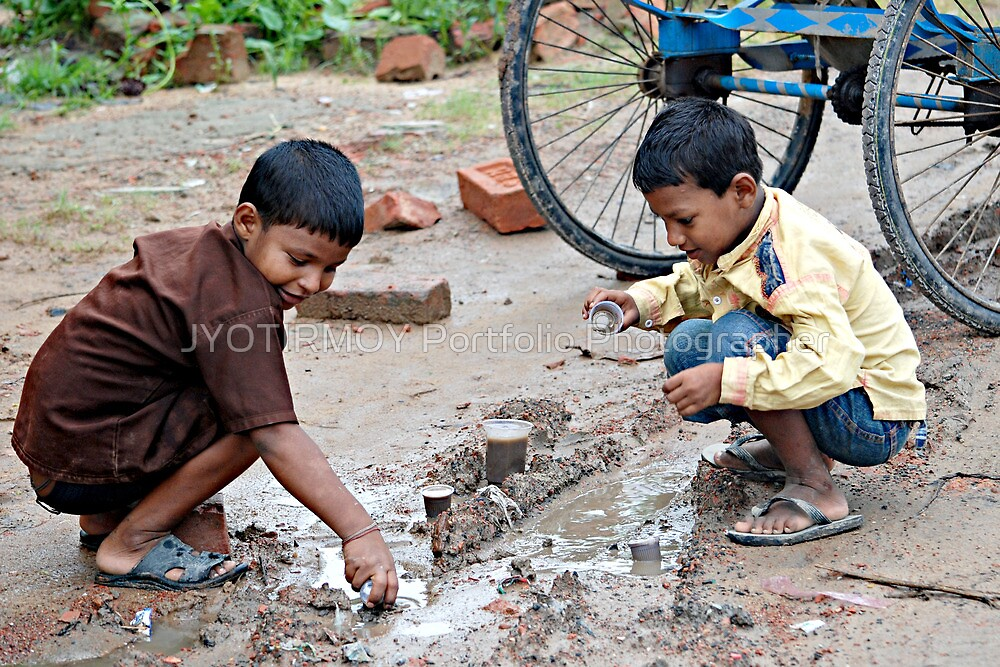 Playing after the rain  by JYOTIRMOY Portfolio Photographer