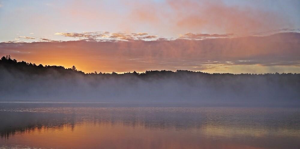 Sunrise Over a Still Lake by corydean