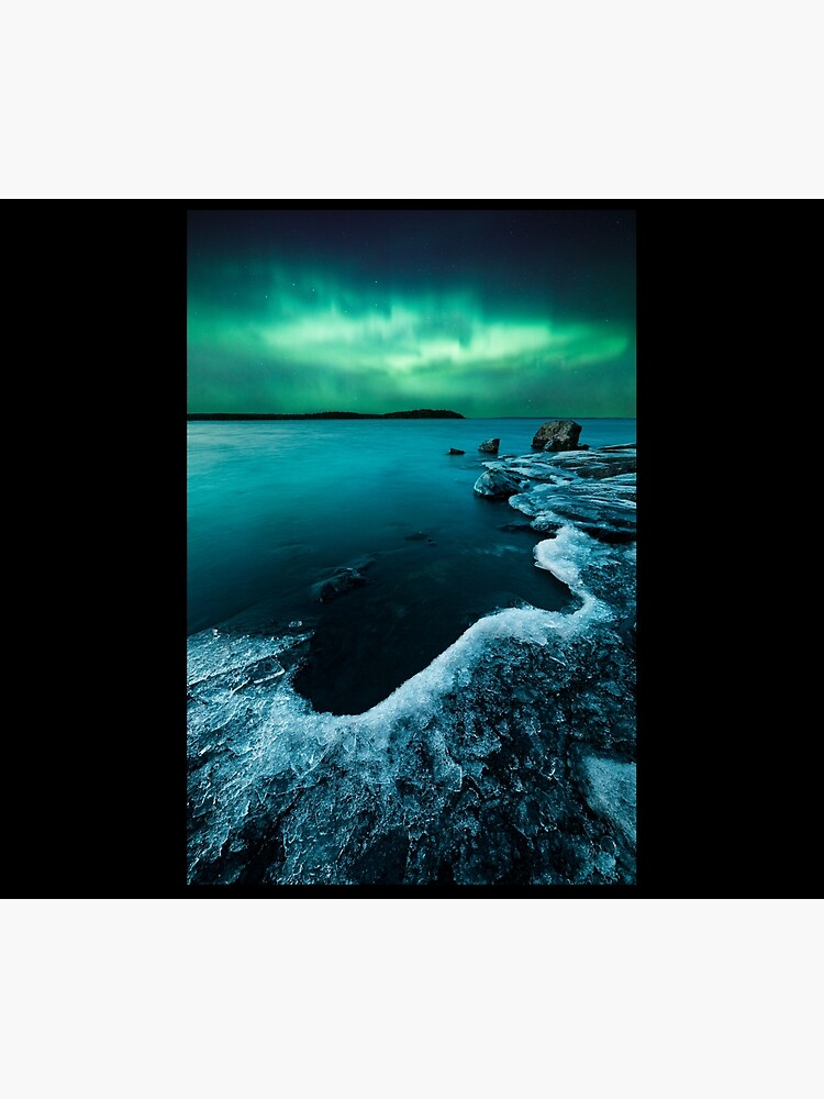 Ice on the lake shore and northern lights landscape by Juhku