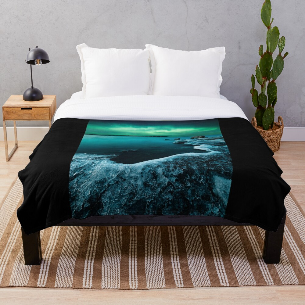 Ice on the lake shore and northern lights landscape Throw Blanket
