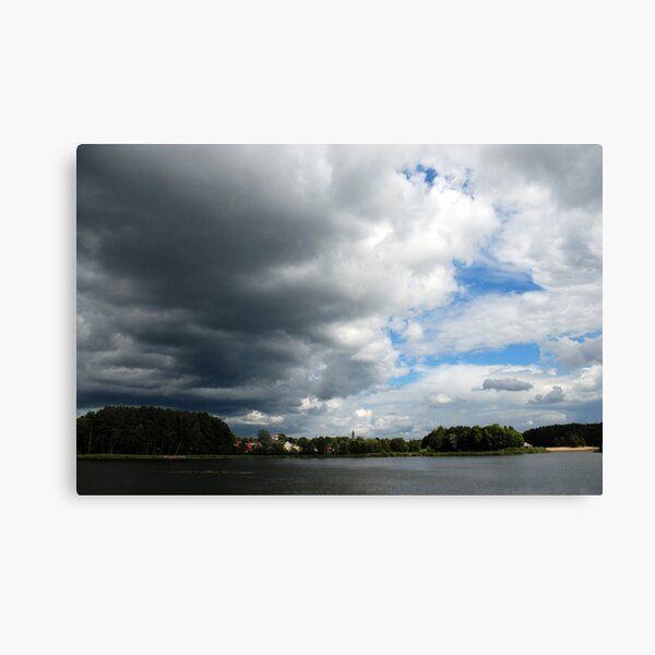 Clouds, lake and town Canvas Print