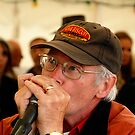 The Harmonica player by SWEEPER