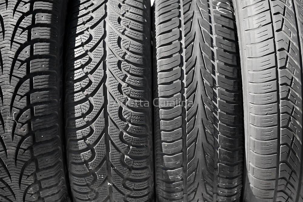 Dirty used black tires row by Arletta Cwalina