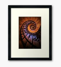 Spiral staircase  in orange and blue Framed Print