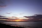 Sunset on Llanfairfechan beach. by Michael Haslam