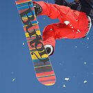 Snowboard jumping on Vogel mountain by Ian Middleton