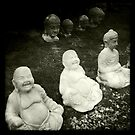 Buddha and other statues, Heacham, Norfolk, UK by Richard Flint