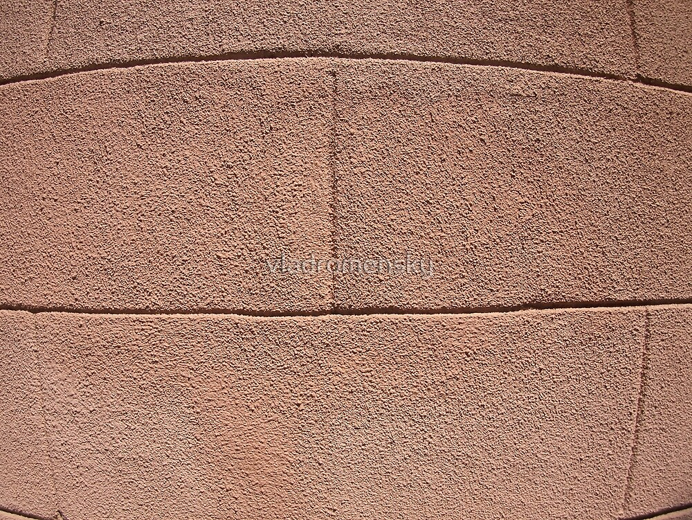 Detail of a decorative wall with a rough coating of cement by vladromensky