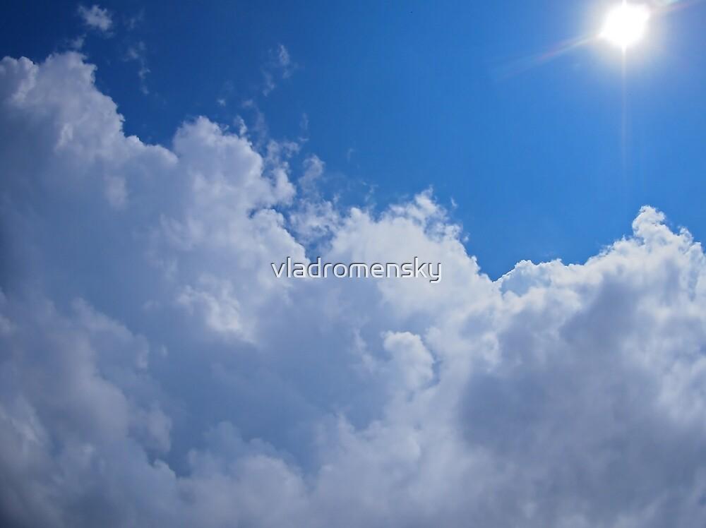 Dark clouds, blue sky and bright sun by vladromensky