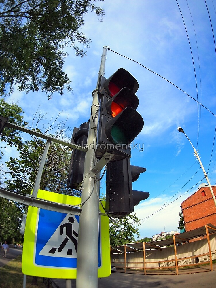 Bottom view on traffic light and road sign closeup  by vladromensky