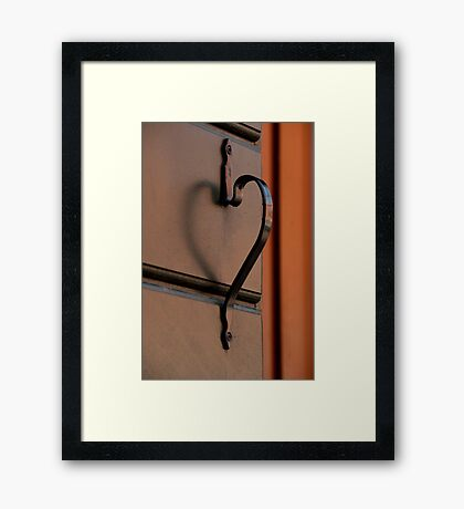 A Doorknob That Has A Heart Framed Print
