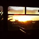 Sunset in a bus - Rhodes Port through the salted window by George Limitsios