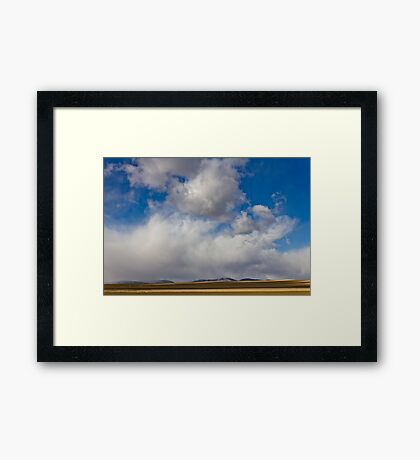 Storm Skies Over The Plains Framed Print