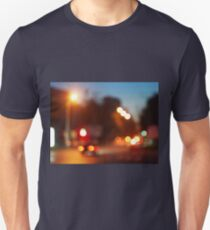 Defocused lights from the headlights and tail lights of cars T-Shirt
