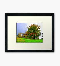 A house on the hill Framed Print