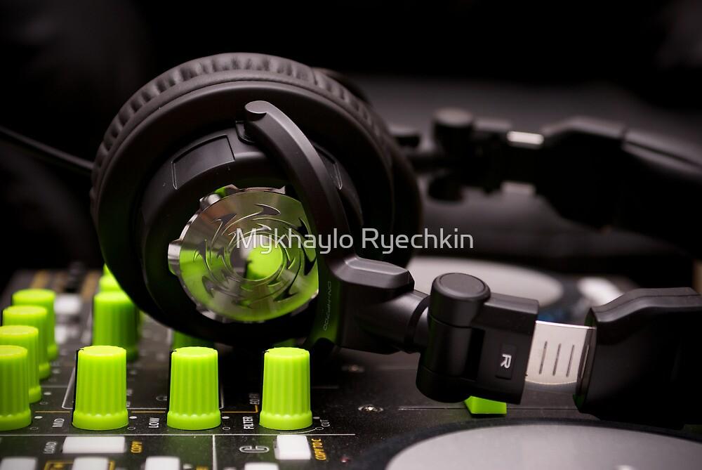 Headphones on a DJ Mixer by Mykhaylo Ryechkin