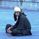 Man in Public Square in New Orleans by photobylorne