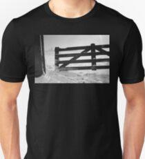 Fence in snow landscape Unisex T-Shirt