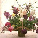 Basket of flowers in window by Garry Gay