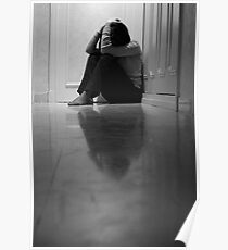 Woman sitting in corridor with head in hands, ground view Poster