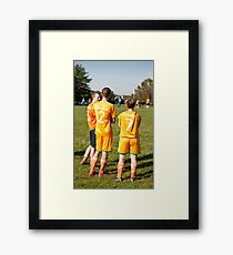 Soccer Team Mates Watch Game Framed Print