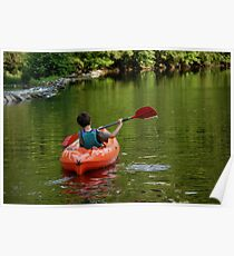 Boy kayaking in river Poster