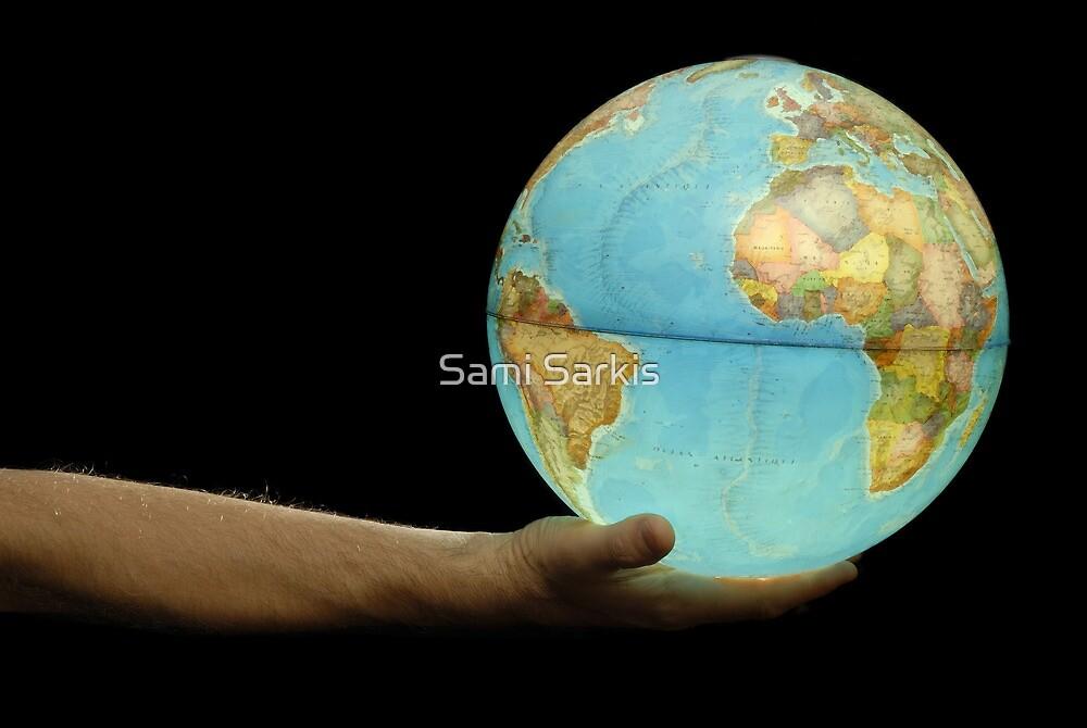 Man offering illuminated Earth globe by Sami Sarkis