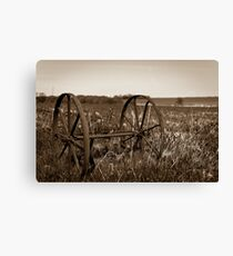 The wheels from an old farmland wagon Canvas Print