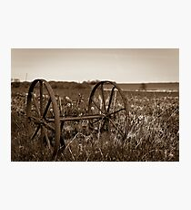 The wheels from an old farmland wagon Photographic Print