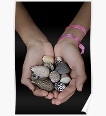 Girl (13-14 years) holding shells in clasped hands Poster