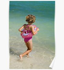 Girl running into water on beach Poster