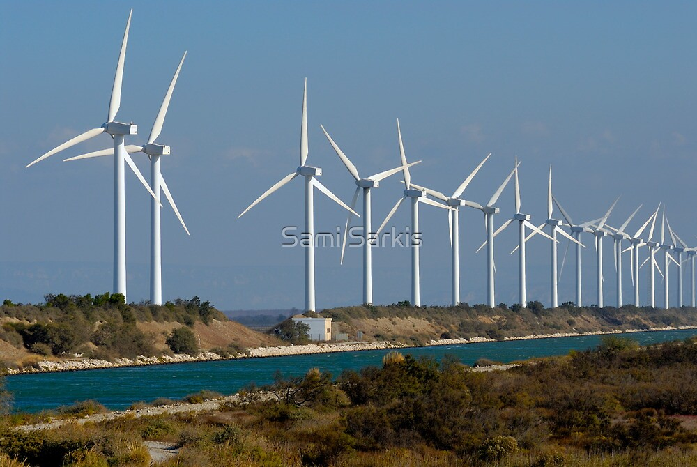 Row of wind turbines along canal, France, Camargue by Sami Sarkis