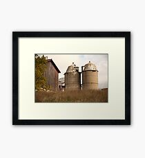 Two Old Silos Talking About the Barn Framed Print