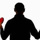 Silhouette of man holding heart and rose by Sami Sarkis
