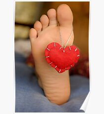 Valentine heart hanging on girl's barefeet Poster