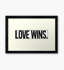 LOVE WINS. Framed Print