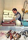 Selling Fish - Gallipoli Italy by Debbie Pinard