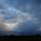 Big sky, dark clouds by agenttomcat