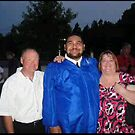 The fam at Sam's grduation by kenroome