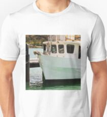 Boat tied to Jetty on a tranquil river Unisex T-Shirt